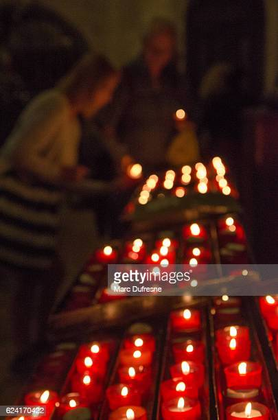 two women lighting candle in the saint mary church - mary moody fotografías e imágenes de stock