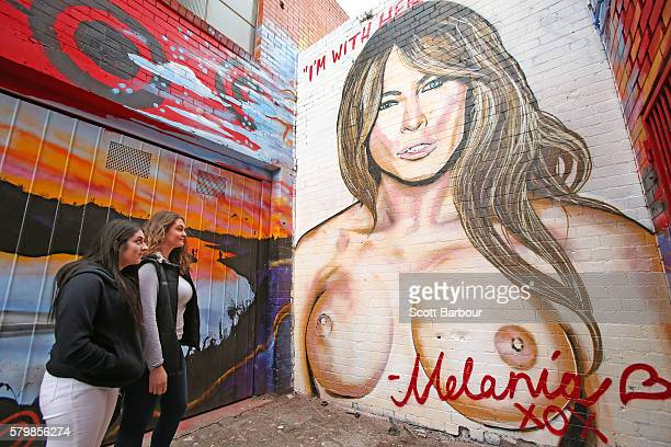 Two women look at a mural by Melbourne graffiti artist Lushsux of Melania Trump the wife of 2016 US presidential candidate Donald Trump in an...
