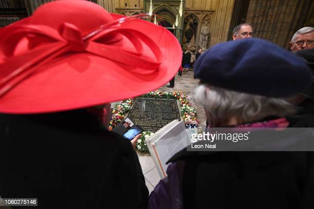 Two women look at flowers laid by Queen Elizabeth II and German President Dr FrankWalter Steinmeier lay together at the grave of The Unknown Warrior...