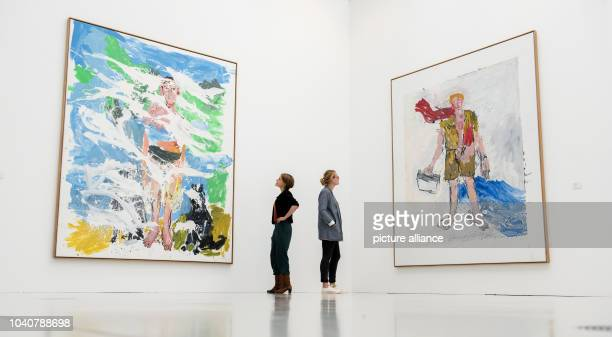 Two women look at the artworks 'B for Larry' and 'The new guy' by artist Georg Baselitz in the exhibition 'Viehof Collection Internation Art in the...