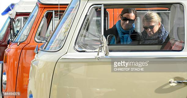 Two women look at vintage Volkswagen buses during an autumn rally of socalled 'Bulli' enthousiasts in front of the abbey Schaeftlarn near Munich...