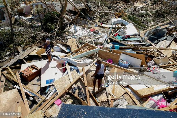 Two women look for lost items after Hurricane Dorian passed through in The Mudd area of Marsh Harbour on September 5 2019 in Great Abaco Island...