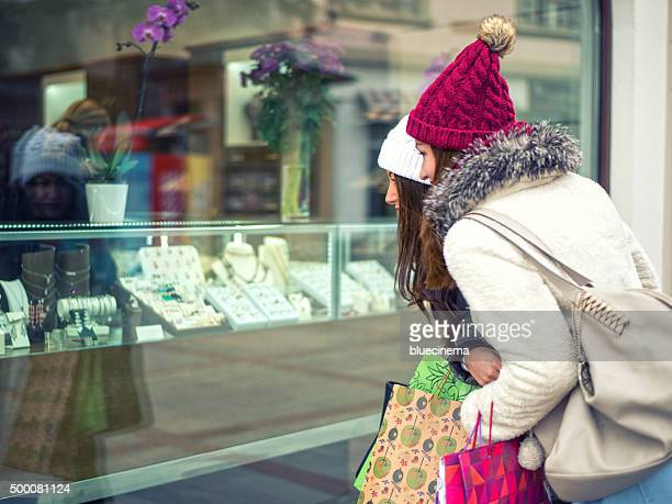 two women looking at a jewelry store window - jewelry store stock pictures, royalty-free photos & images