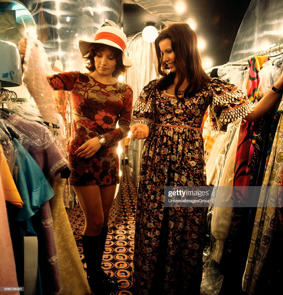 Two women looking at dresses in 'Stop the Shop', King's Road, Chelsea, London, 1971 : News Photo