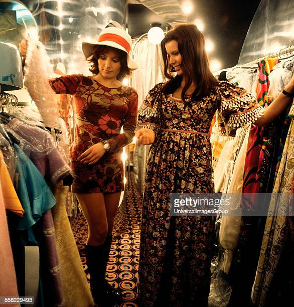 Two women looking at dresses in 'Stop the Shop' King's Road Chelsea London 1971