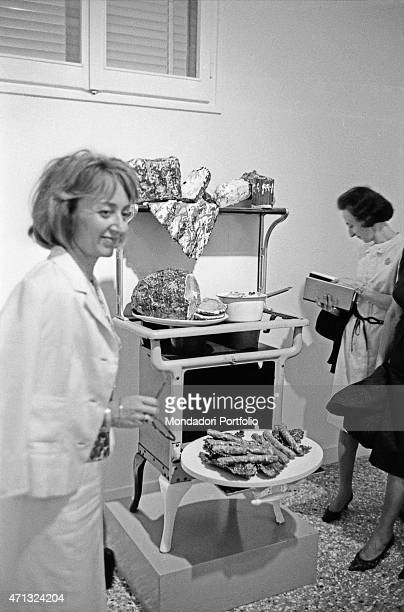 Two women looking at Stove by Claes Oldenburg at the 32nd Art Biennale Venice June 1964