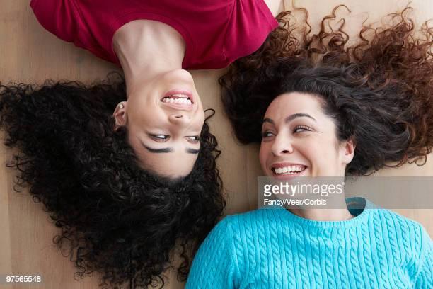 Two women lying on the floor