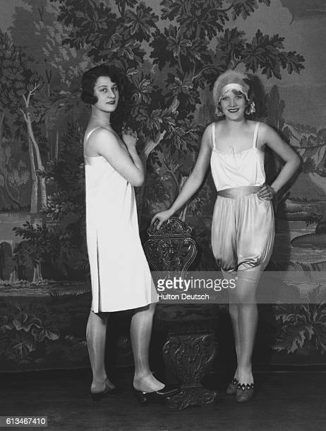 Two women model Campbells underwear One wears a wrap around slip while the other sports bloomers and a camisole top