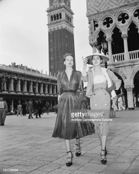 Two women modelling Christian Dior outfits on the Piazza San Marco in Venice 3rd June 1951 In the background is St Mark's Campanile