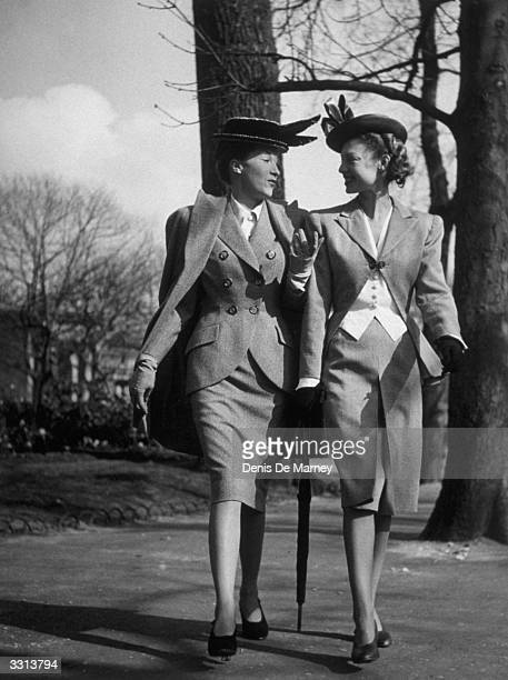Two women modelling spring fashions in the park