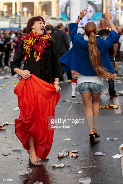 Two women of the german fans celebrate dancing after they watched the FIFA World Cup 2014 group G football match Germany vs USA at the Hyundai Fan...