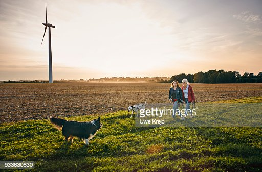 Two women on a dog walk in the countryside