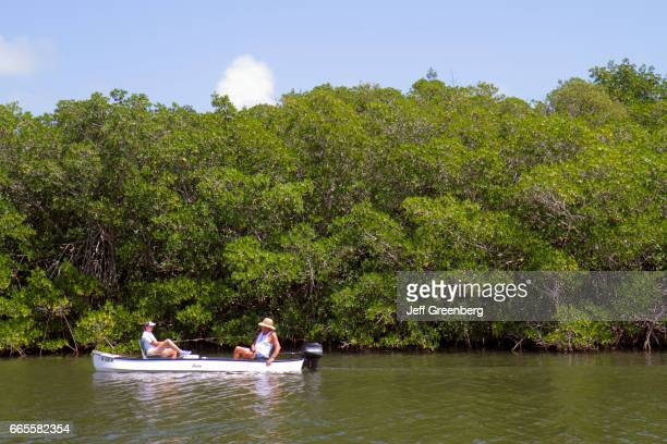 Two women on a outboard motorboat at Florida Bay