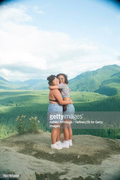 two women on mountain top - noapologiescollection stock pictures, royalty-free photos & images