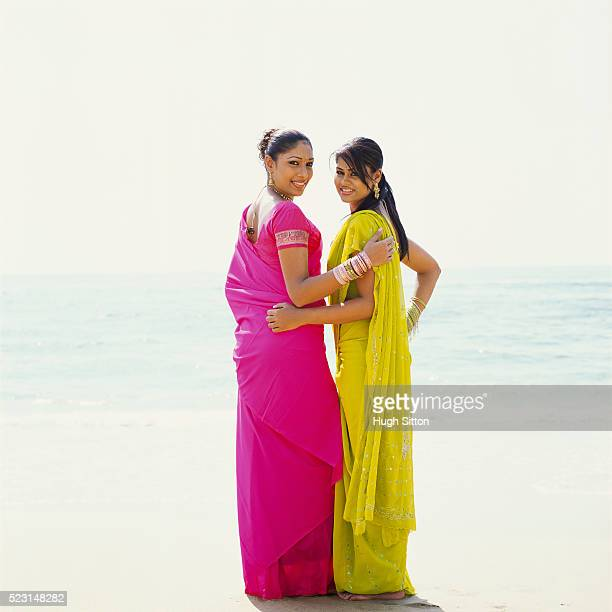 two women on the beach - hugh sitton stock pictures, royalty-free photos & images