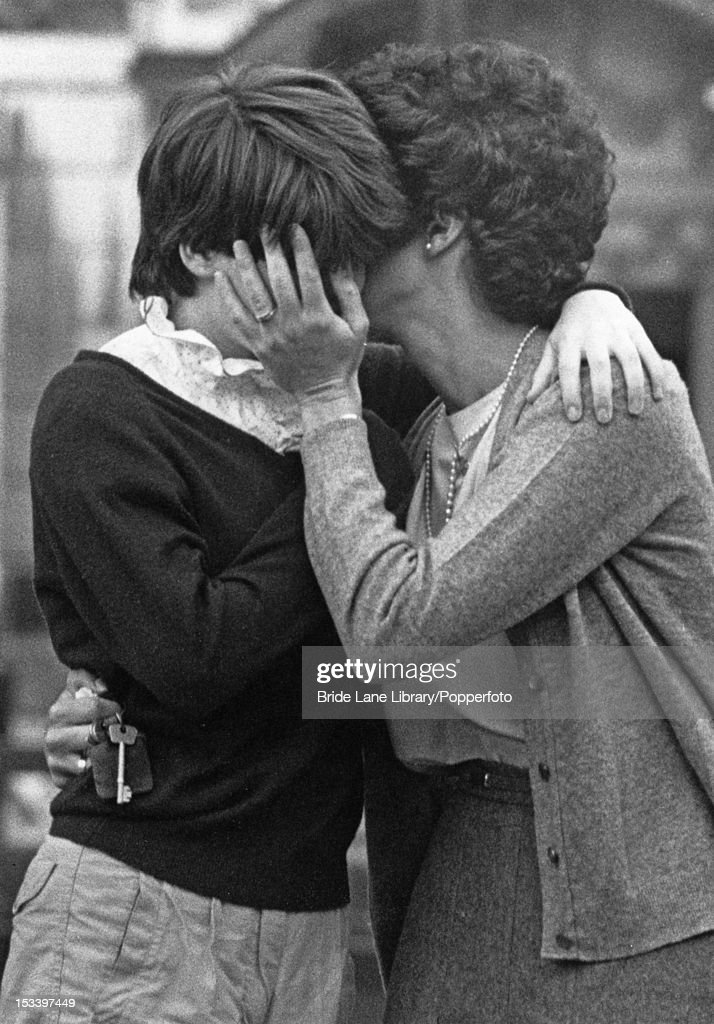 Two women, one believed to be the widow of a cavalryman, console each other as a military parade by the Blues and Royals cavalry regiment, passes through Hyde Park, London, 22nd July 1982. The traditional parade continues, despite the Provisional IRA car bombing, which killed five soldiers and seven horses during a parade two days earlier.