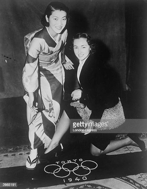 Two women, one wearing a kimono, with a banner for the Tokyo Olympic Games of 1940, which is made of pearls worth ?6,000. The Games were cancelled...