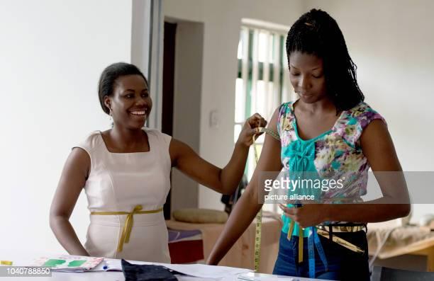 Two women participate in a tailoring class at a fashion studio in the region of Abuja nigeria 10 October 2016 PHOTO MONIKA SKOLIMOWSKA/dpa | usage...