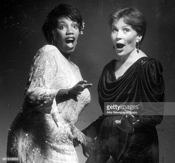 Two women performers singing side by side on stage 1974