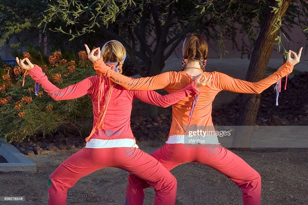 Two Women performing yoga Model Released.
