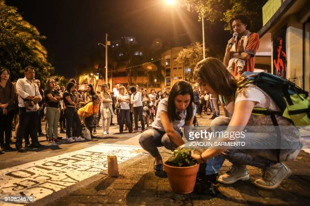 Two women plant a tree that symbolizes the death of Temistocles Machado a murdered activist from the port city of Buenaventura during a tribute to...