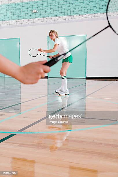 two women playing badminton - badminton sport stock photos and pictures