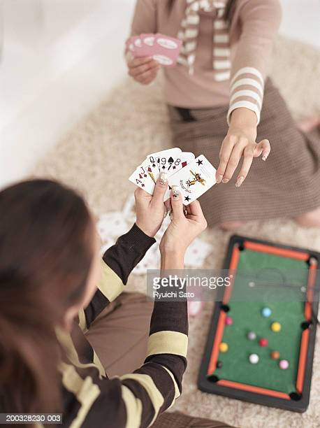 Two women playing cards, elevated view