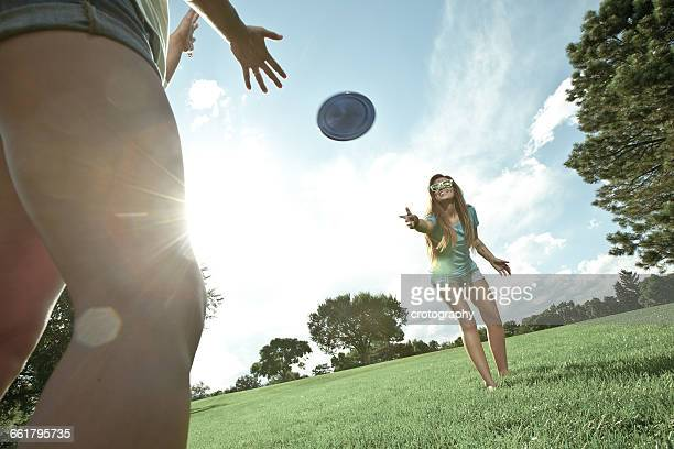 Two women playing game of Frisbee in park