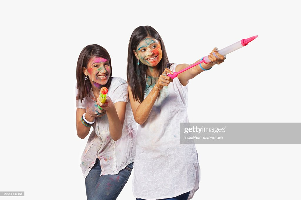 Two women playing holi : Stock Photo