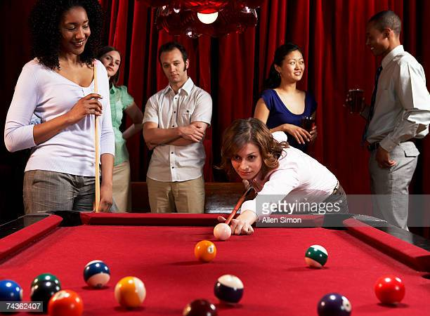Two women playing pool at pub