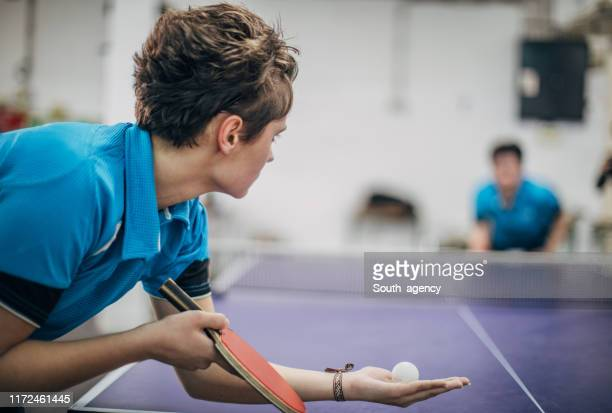 two women playing table tennis - table tennis stock pictures, royalty-free photos & images