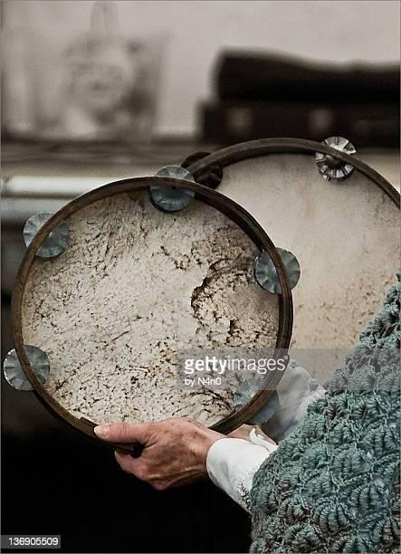 Two women playing tambourine