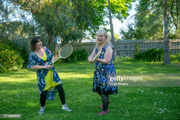 two women playing tennis in my backyard - tennis stock pictures, royalty-free photos & images