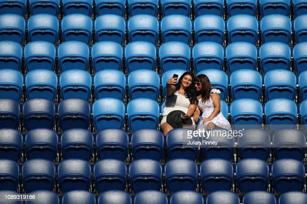 Two women pose for a selfie in Rod Laver Arena during the junior boys singles final between Lorenzo Musetti of Italy and Emilio Nava of the United...