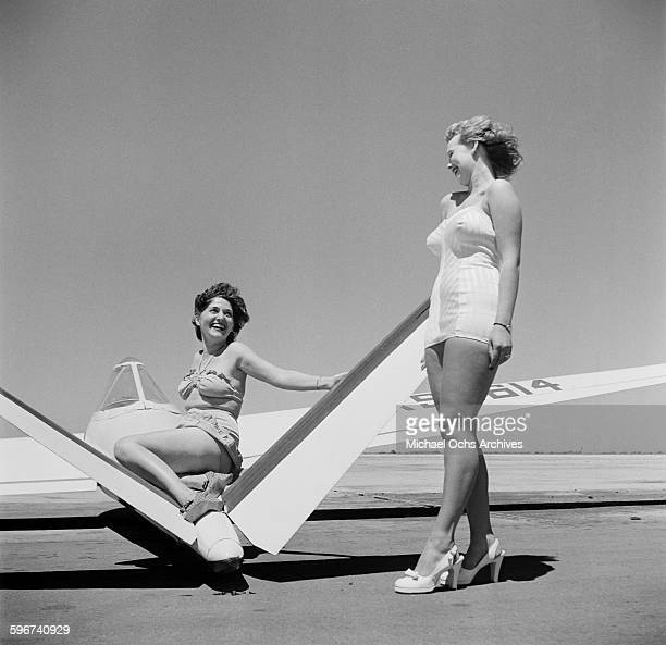 Two women pose next to a glider during the gliding competition in PalmdaleCalifornia