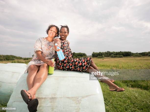 Two women posing with their weapon after a water fight