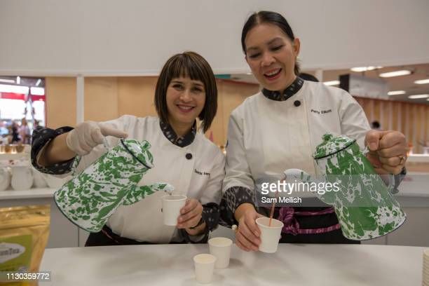 Two women pouring tea during day two of the London Book Fair on the 13th March 2019 at London Olympia in the United Kingdom
