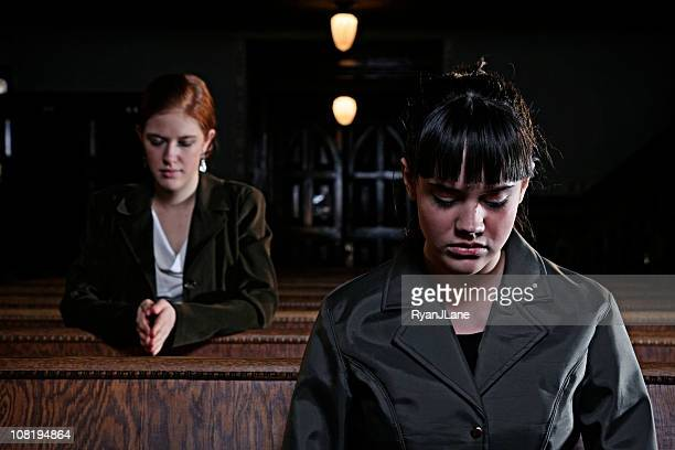 two women praying in an old church cathedral - chapel stock pictures, royalty-free photos & images