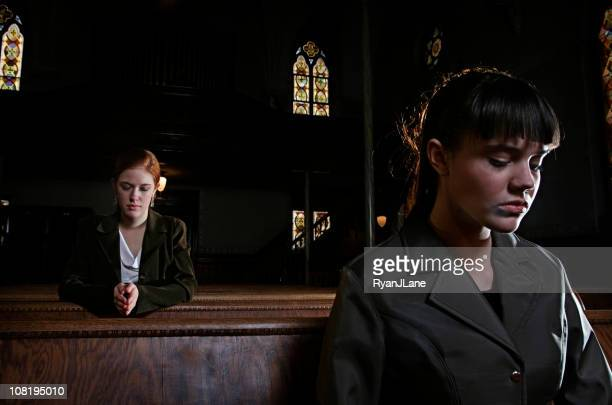 Two Women Praying in an Old Church Cathedral