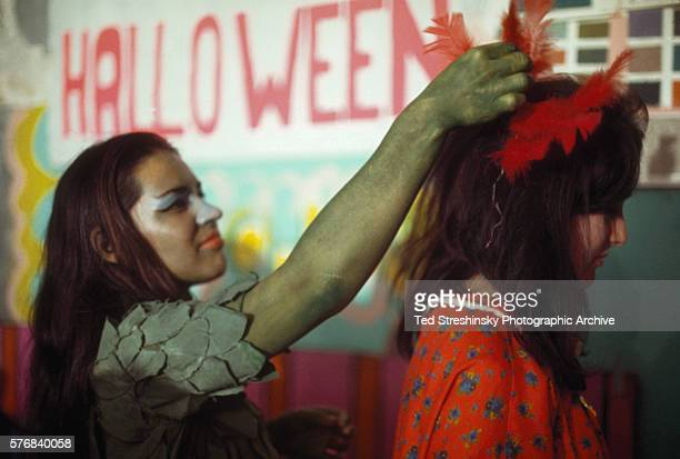Two women prepare for the Acid Test Graduation a celebration organized by Ken Kesey and his Merry Pranksters in which participants graduated beyond...