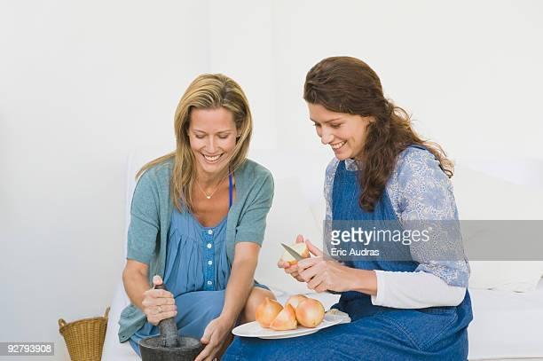 Two women preparing food at home