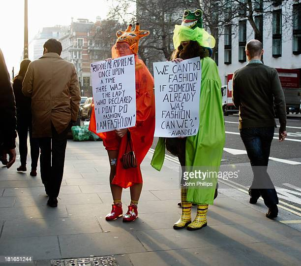 Two women protest outside the entrance to London Fashion Week held in the courtyard of Somerset House in The Strand.