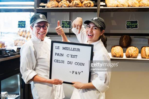 Two women, proud owners of a small local bakery shop.