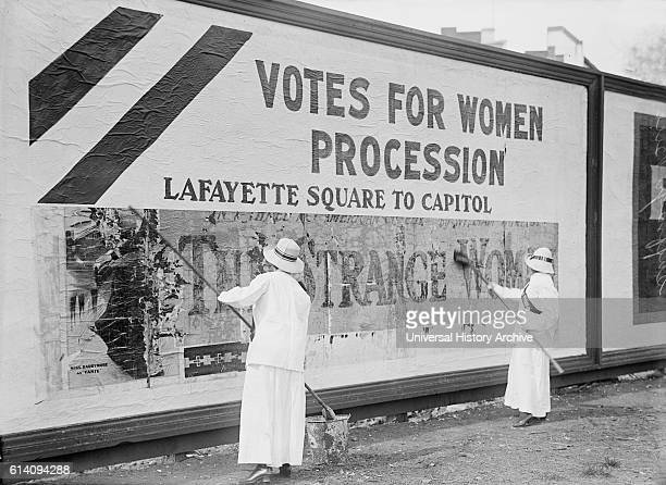 Two Women Putting Up Poster for Women's Suffrage Parade Washington DC USA circa 1914