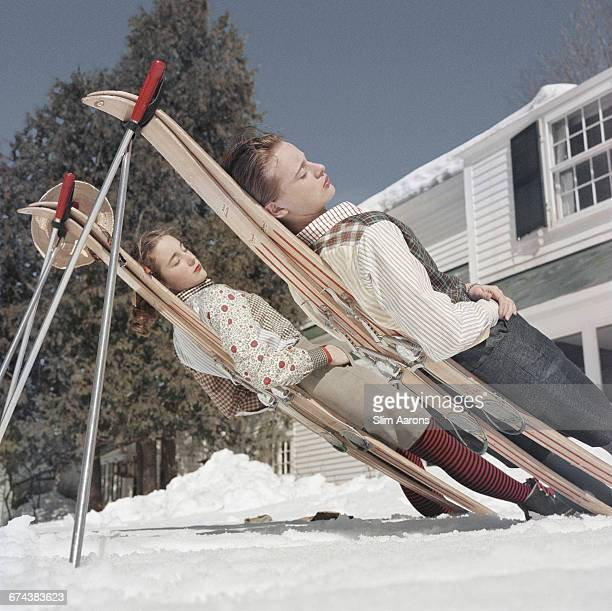 Two women recline on improvised sunbeds in Cranmore Mountain New Hampshire circa 1955