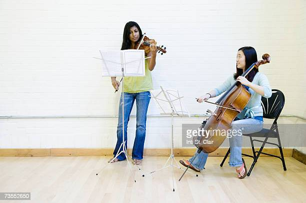 Two women rehearsing in music studio