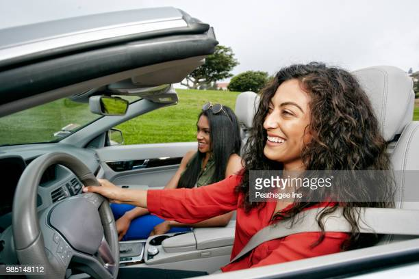Two women riding in a covertible