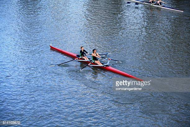 Two Women Rowing Competively