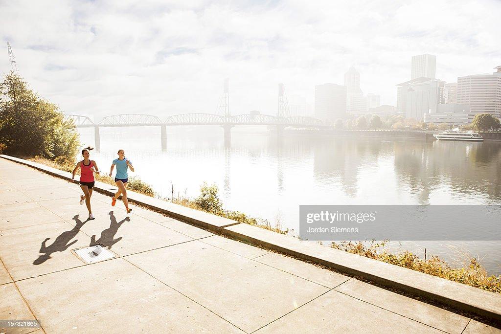 Two women running for exercise. : Bildbanksbilder