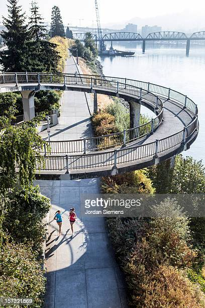 two women running for exercise. - portland oregon stock pictures, royalty-free photos & images